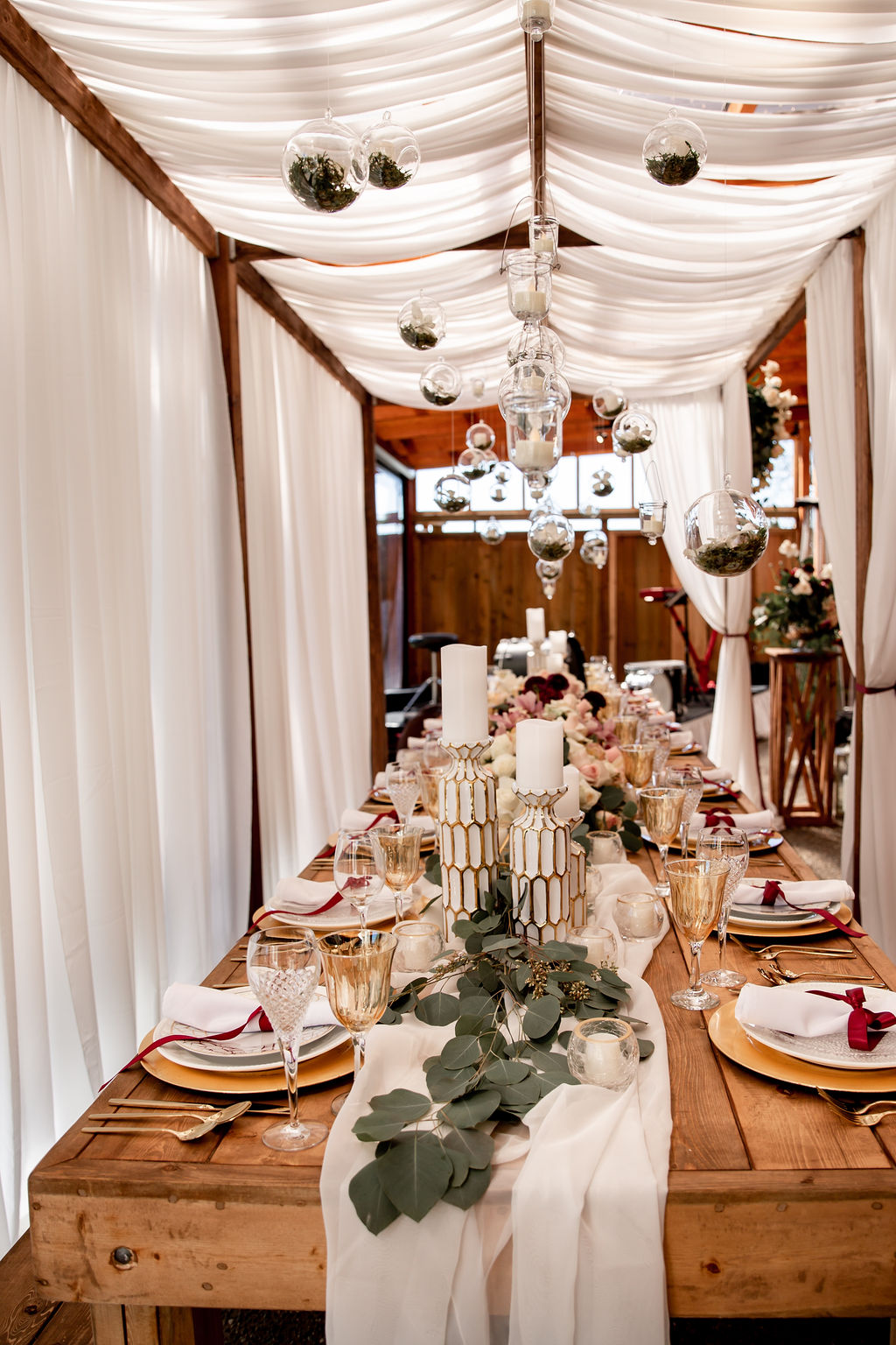 Trestle table with white curtains for wedding reception by Ellssi Vancouver