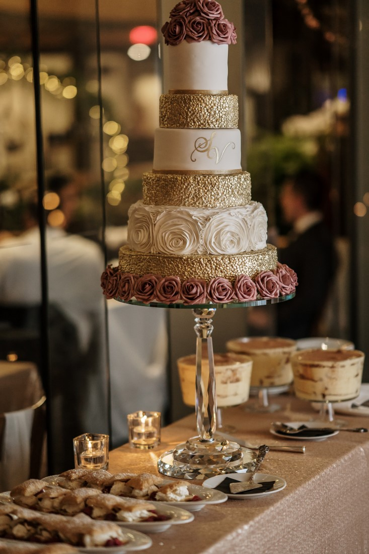 Five tiered gold and white wedding cake by Ooh La La Cupcakes