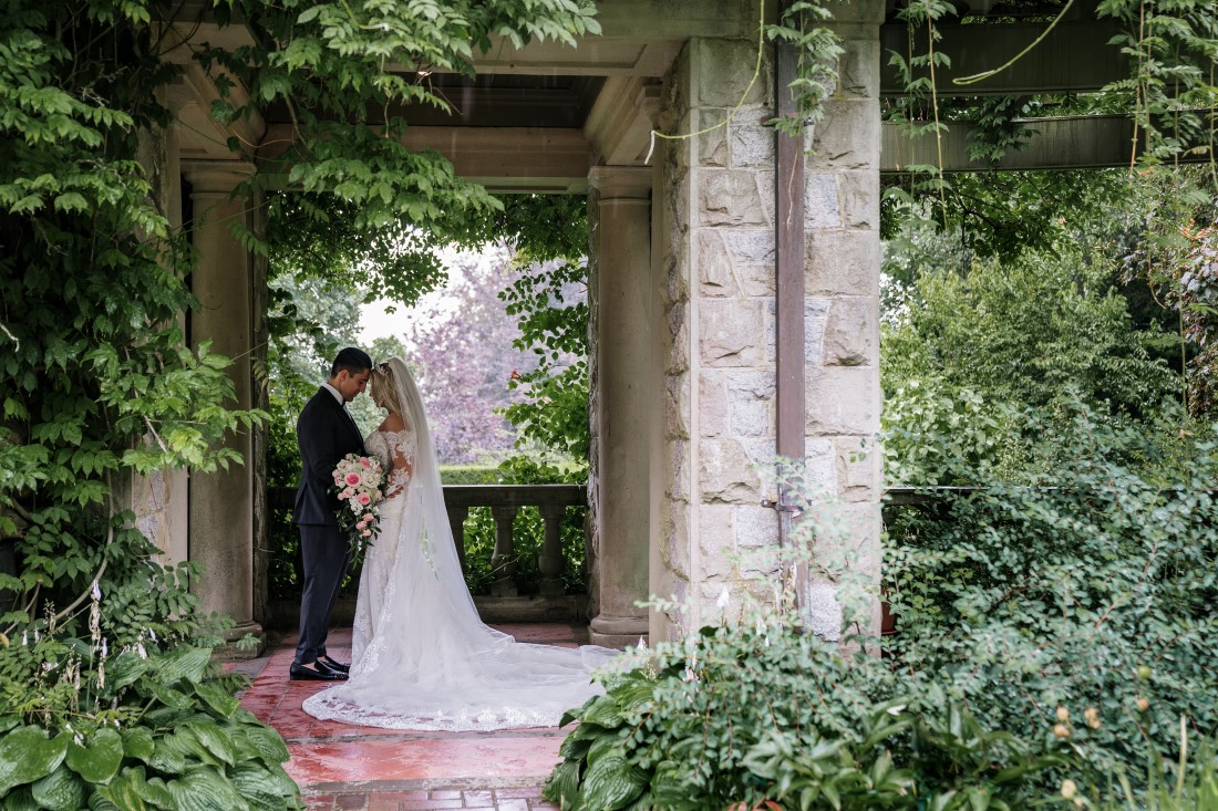Newlyweds in the ivy gardens of Hatley Castle Vancouver Island