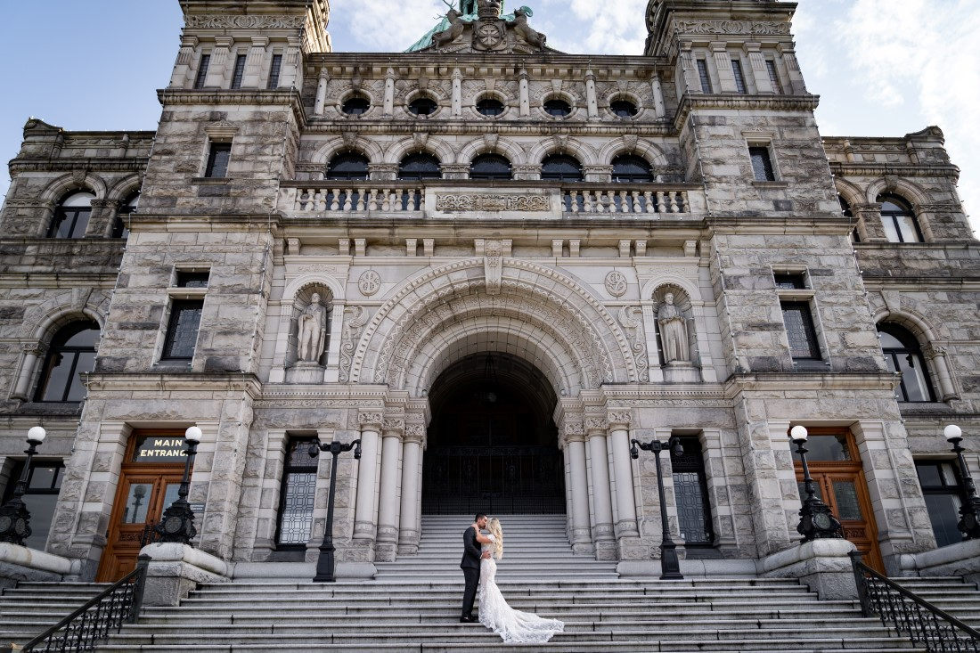 Newlyweds in front of BC Parliament by Ross Kyjer Photography