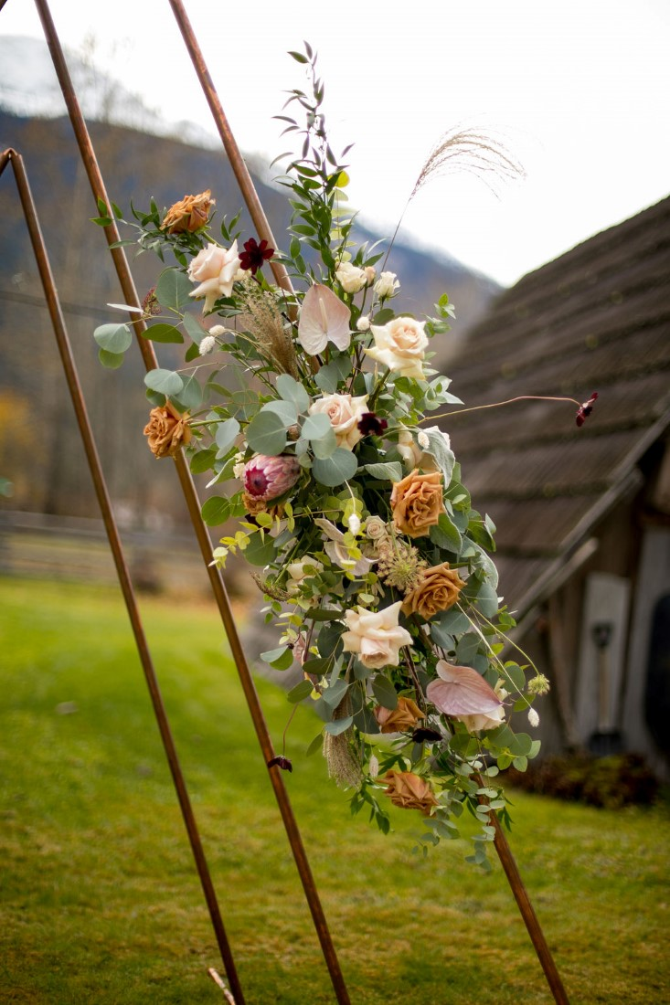 Floral Design on ceremony arch by Within Us Flowers