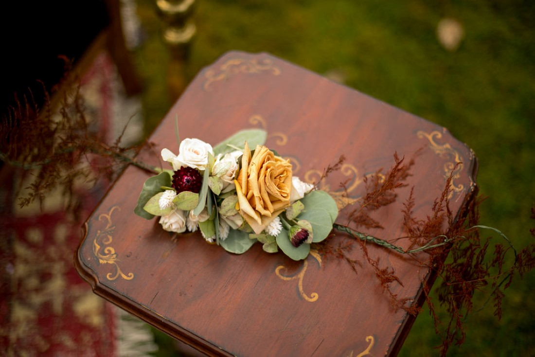 Floral on small wooden table of wedding lounge furniture