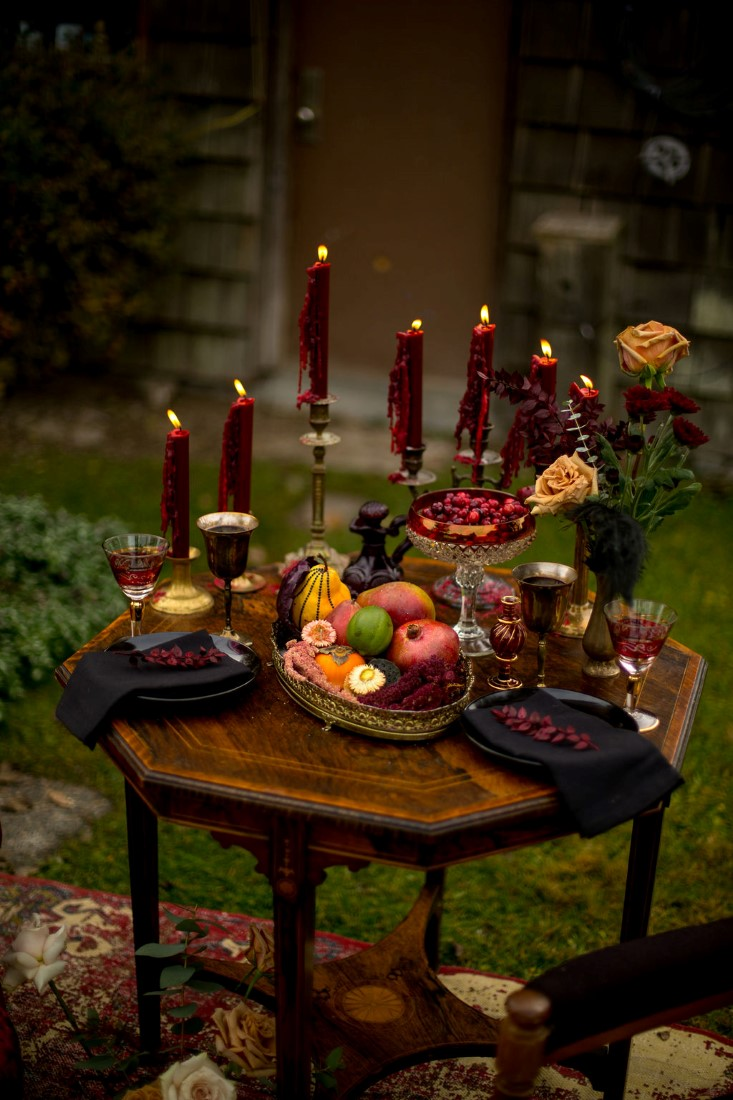 Breathtaking Wedding Beauty table filled with burgundy tall candles and bright roses