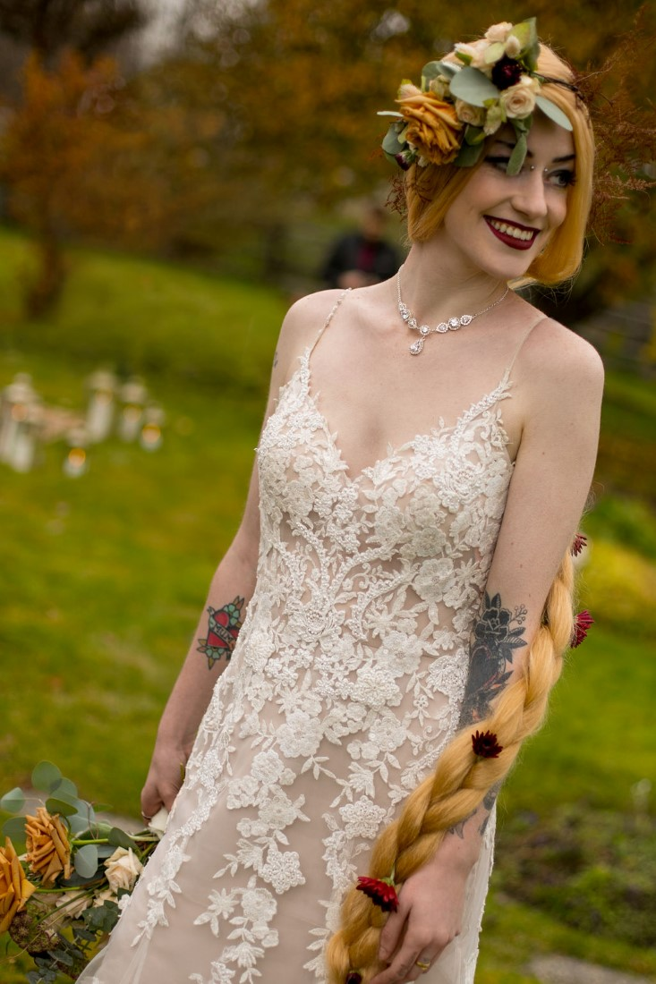 Bride in white lace gown and long blonde braid with floral crown by Isabelle's Bridal Vancouver