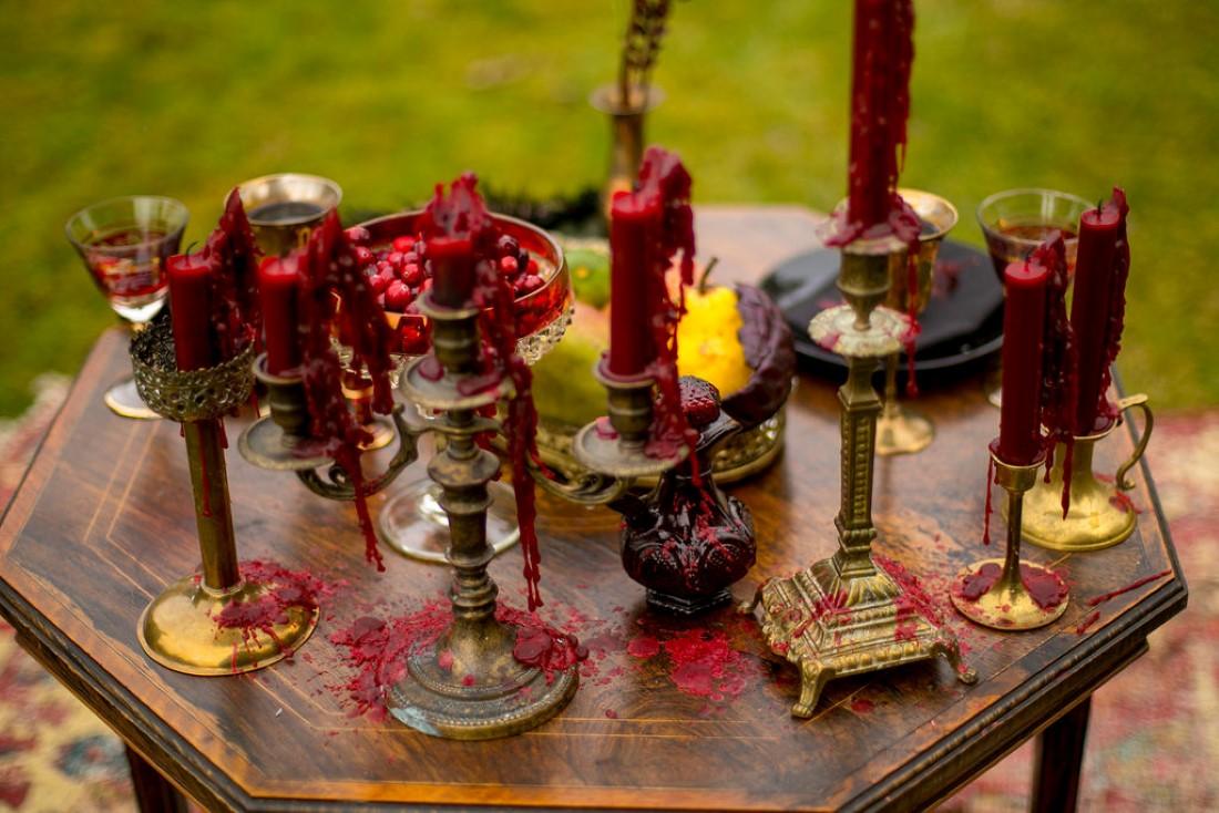 Burgundy and orange roses with tall candlesticks wedding decor