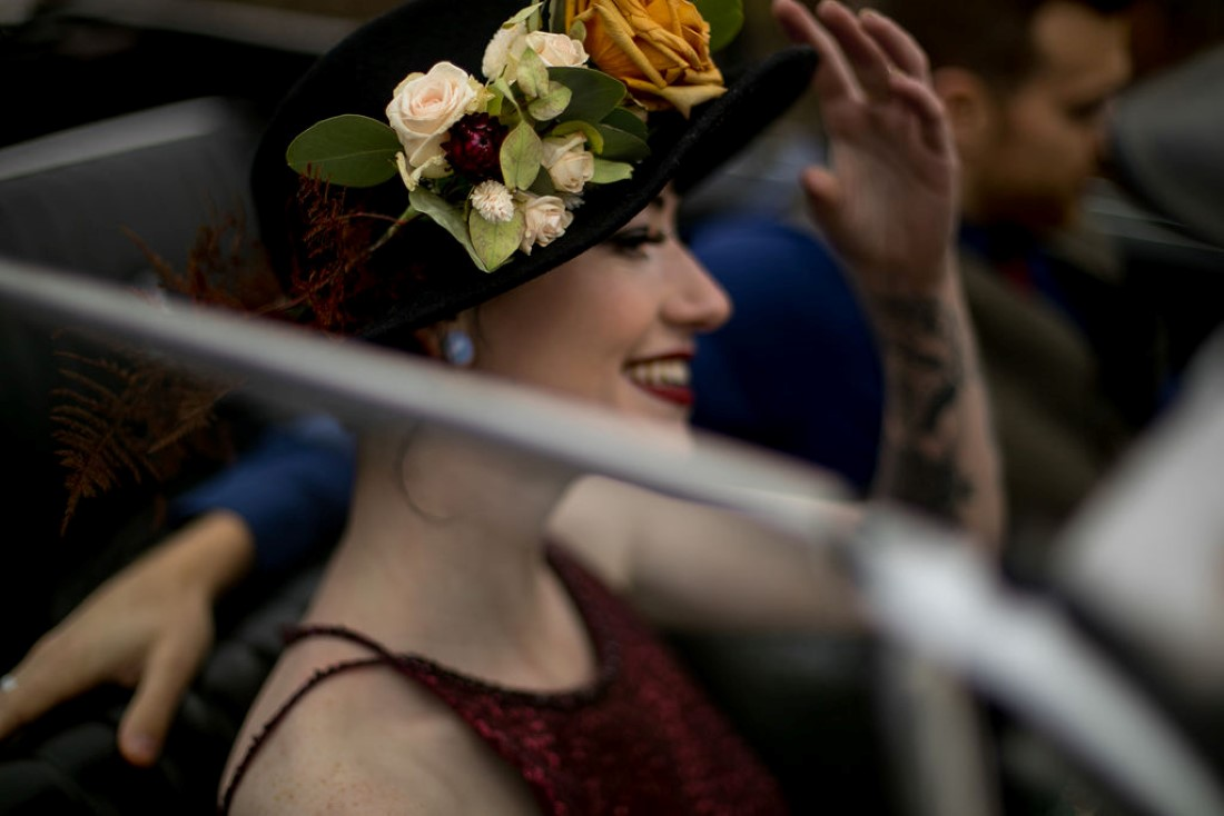 Bride wears black hat covered in floral by Isabelle's Bridal Vancouver