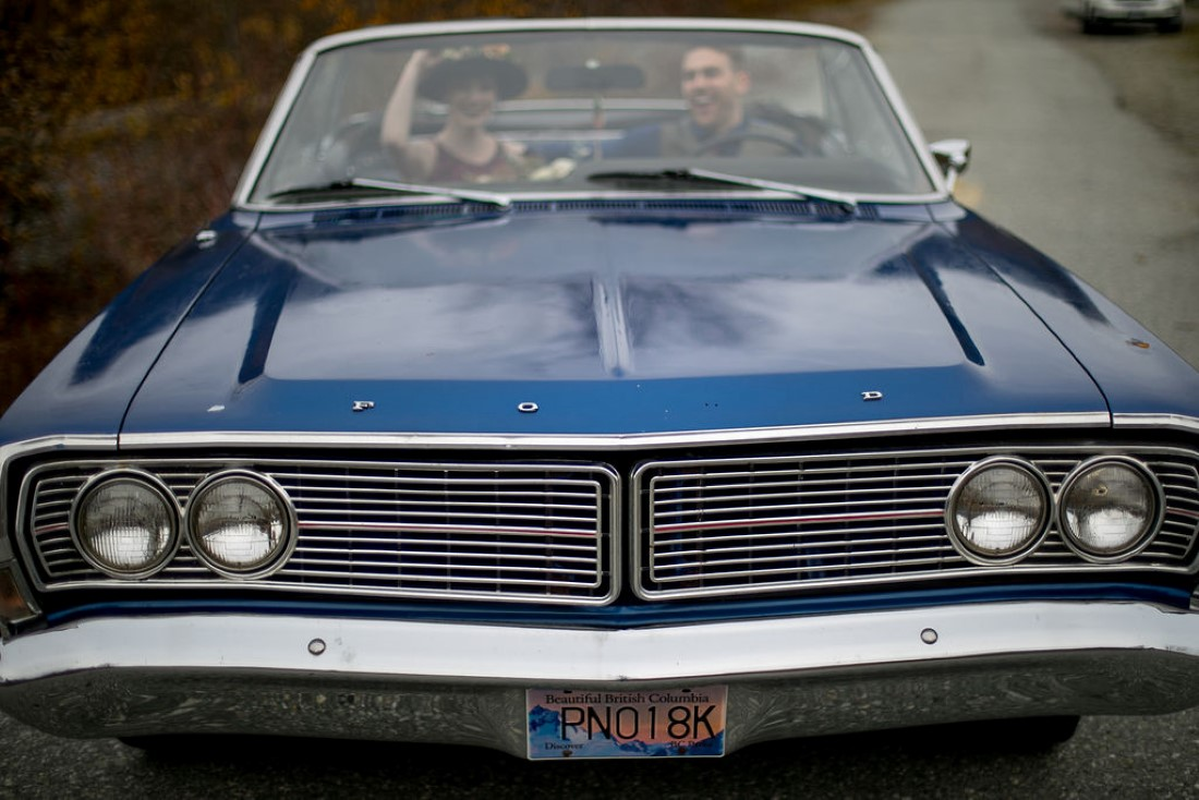 Newlyweds in classic blue car by Meghan Andrews Photography