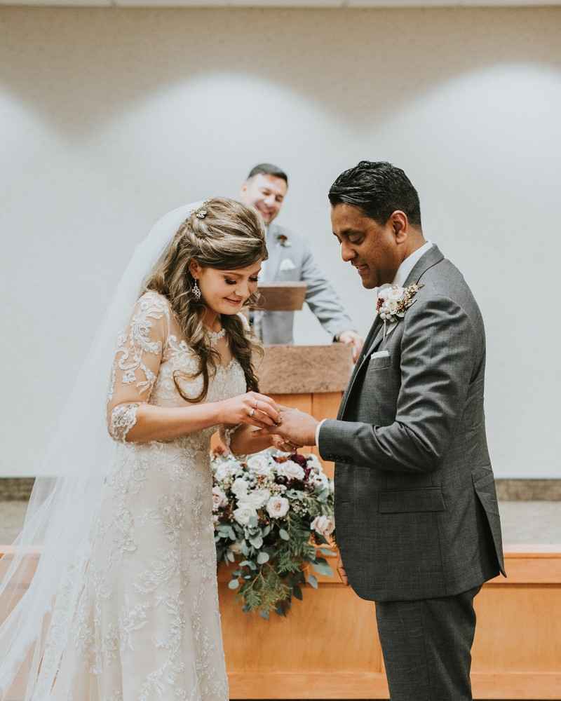 Bride and groom exchange rings at ceremony