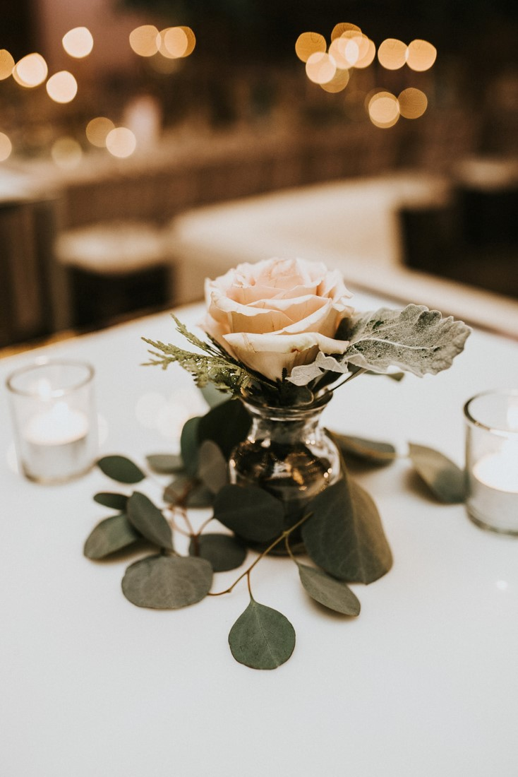 Blush Pink Rose surrounded by eucalyptus on wedding table