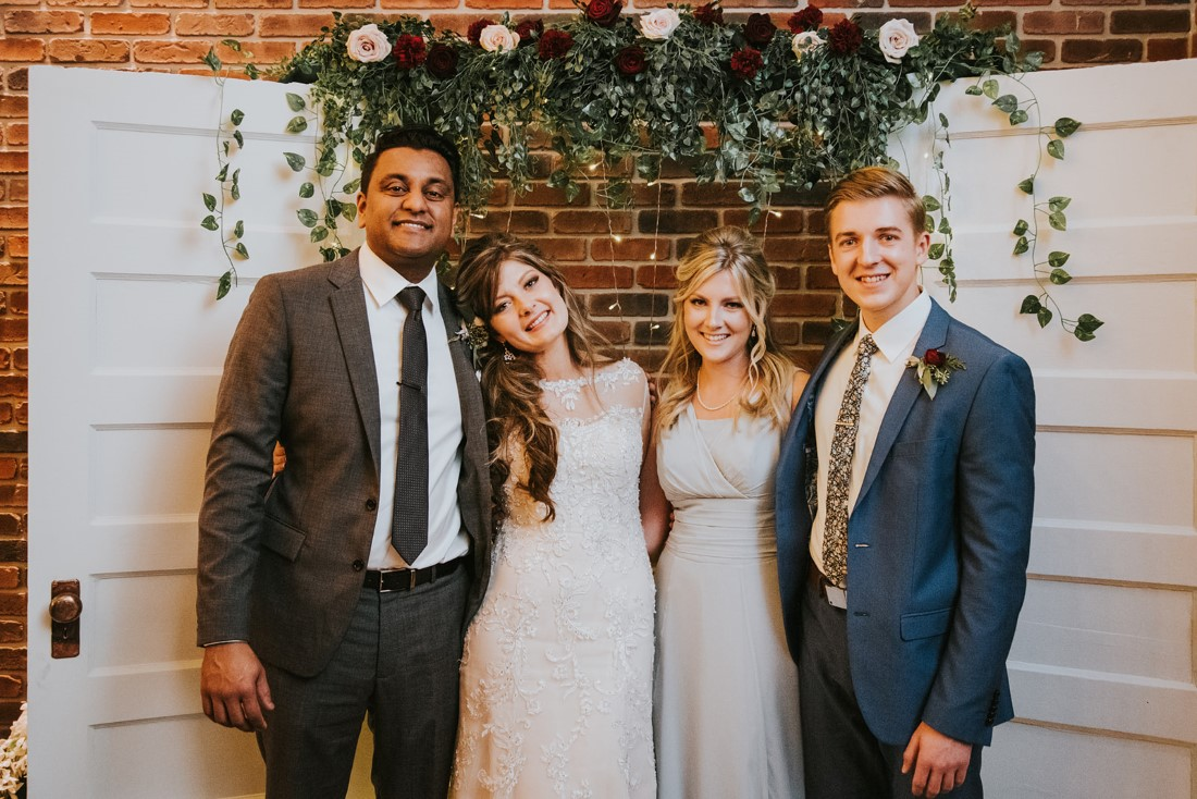 Photo Booth made of white antique doors with floral cascading above