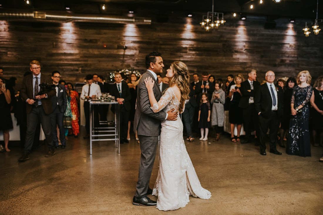 Newlyweds first dance in front of guests