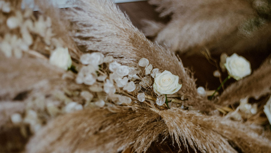 Pampas grass and white roses bridal bouquet by Van Simone Flowers