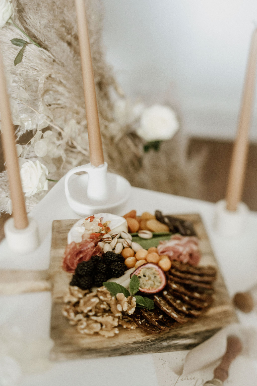 Gorgeous charcuterie platter on wedding table by Miel Snack Platters Vancouver