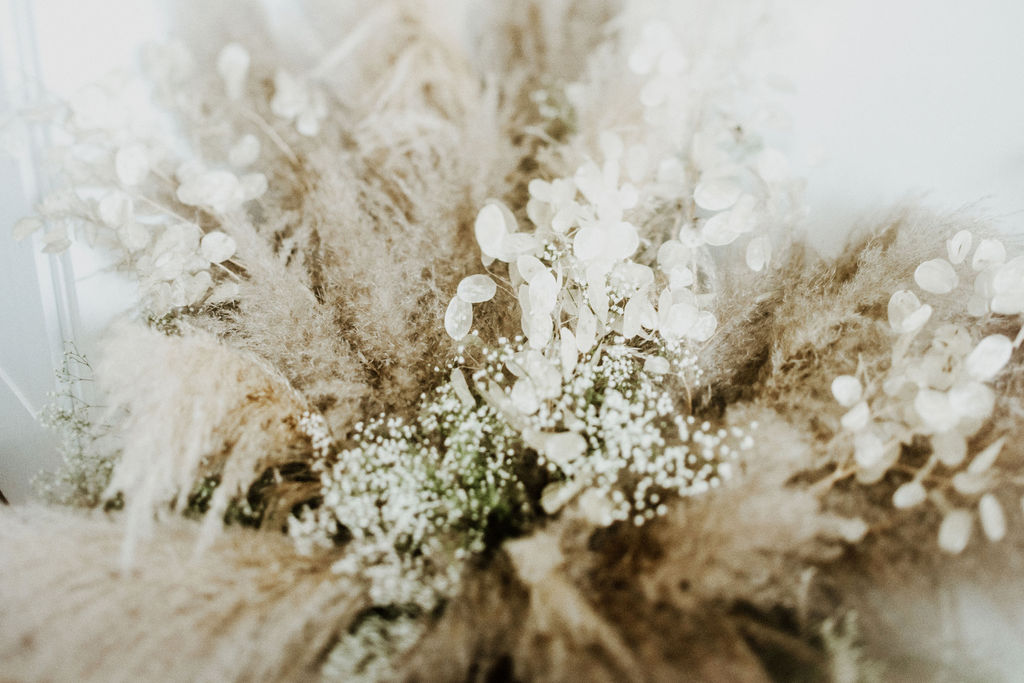 Pampas grass and white flowers in bride's bouquet by Van Simone Florals Vancouver