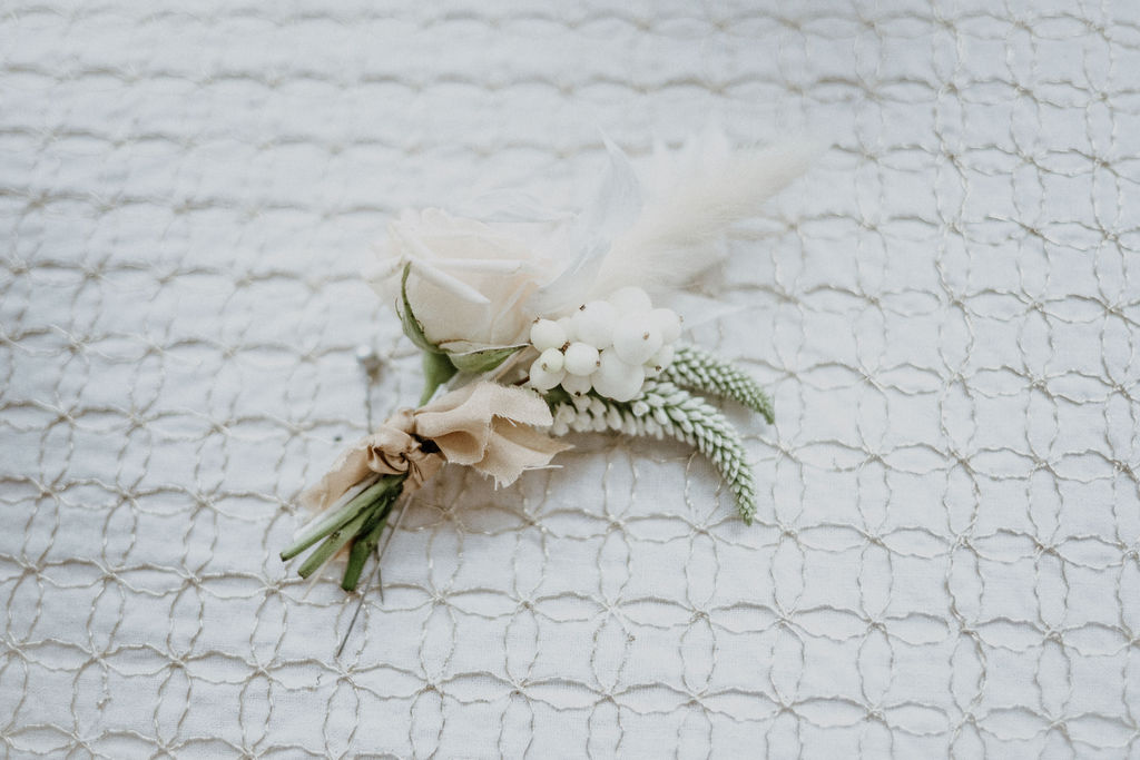 Boutonierre for Groom with white rose and pampas grass
