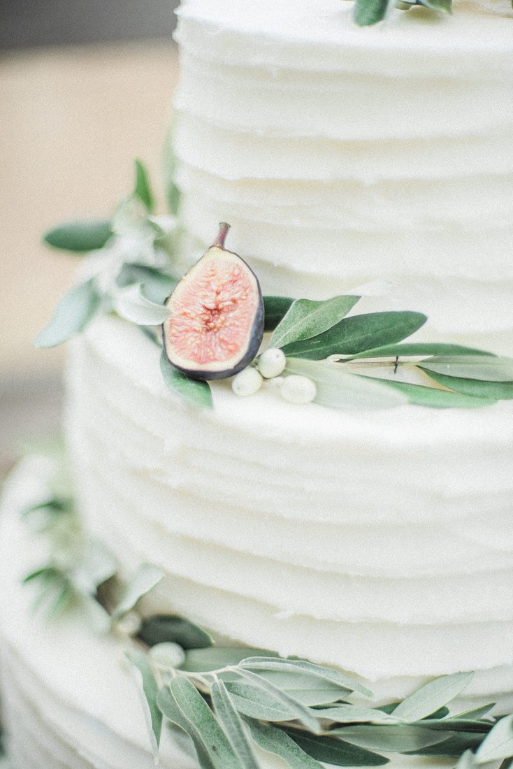 White cake with greenery by Taylor Made Cakes