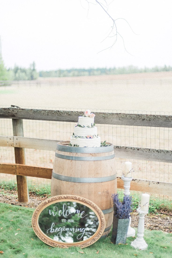 Wedding Cake on Barrel beside country fence