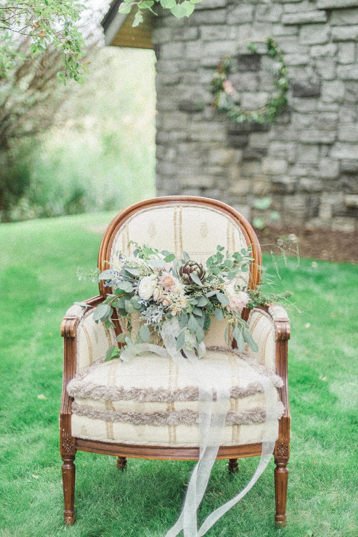 Bridal Bouquet sits on white french country chair by Dream Day Bouquet