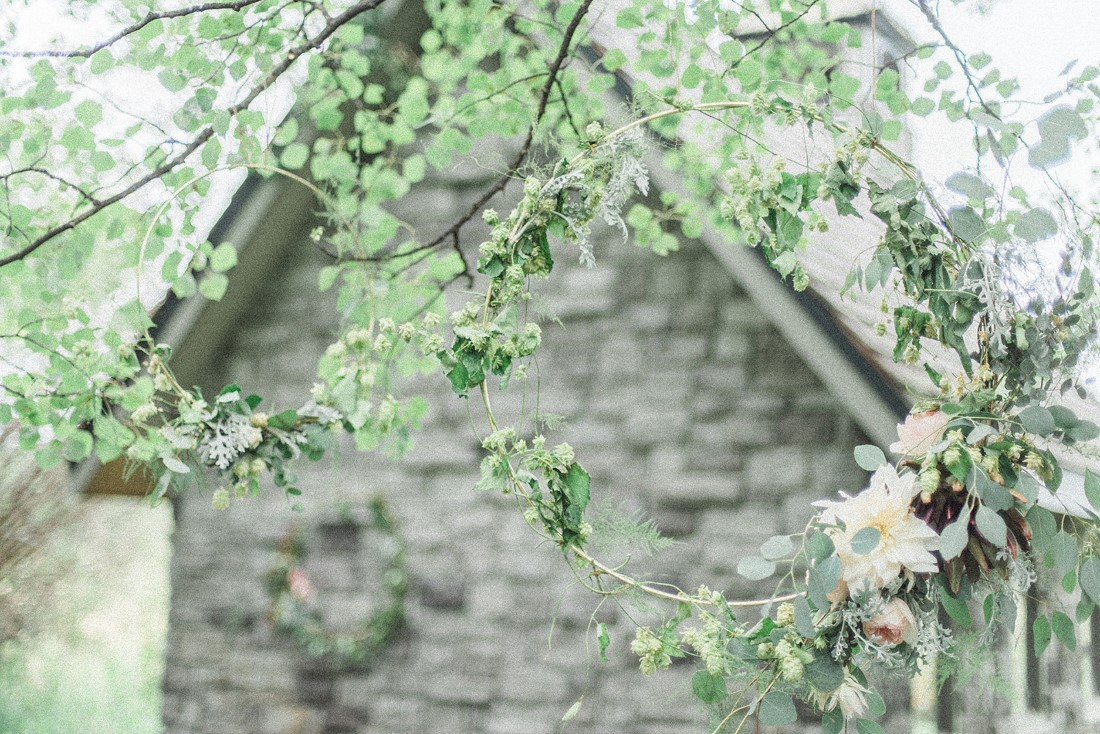 French Country Wedding antique grey barn covered in greenery