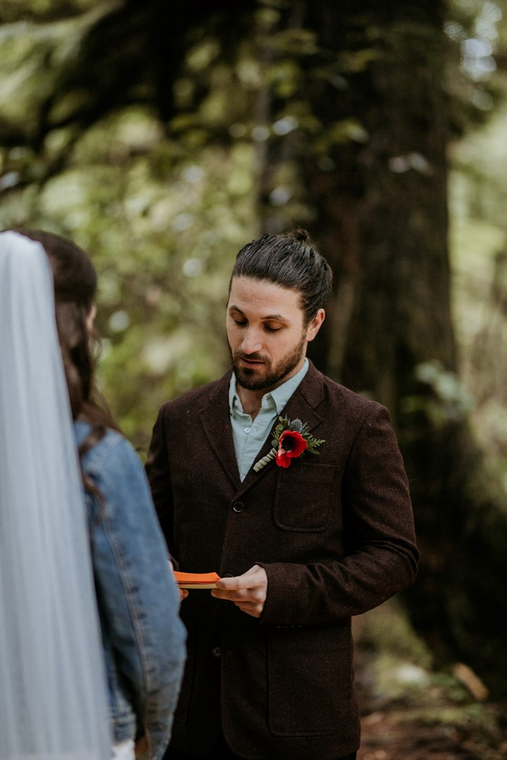 Groom shares wedding vows in Tofino forest