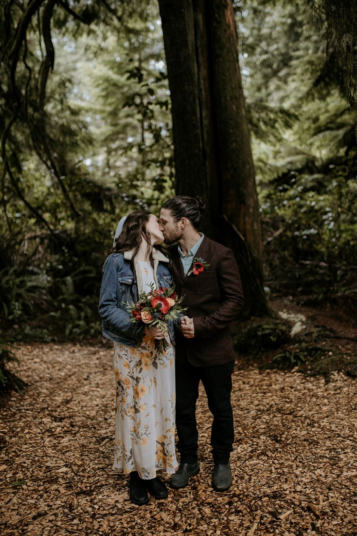Tofino Vows couple kiss after wedding ceremony at Wickaninnish Inn