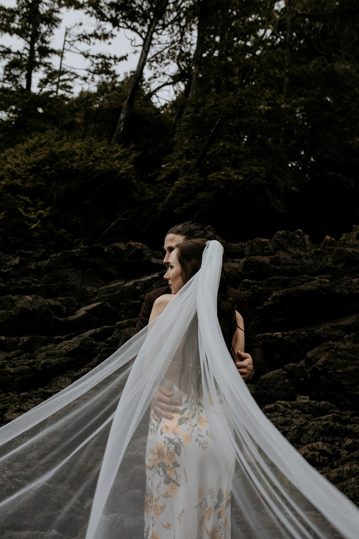 Tofino Vows bride with veil spread around her on the beach