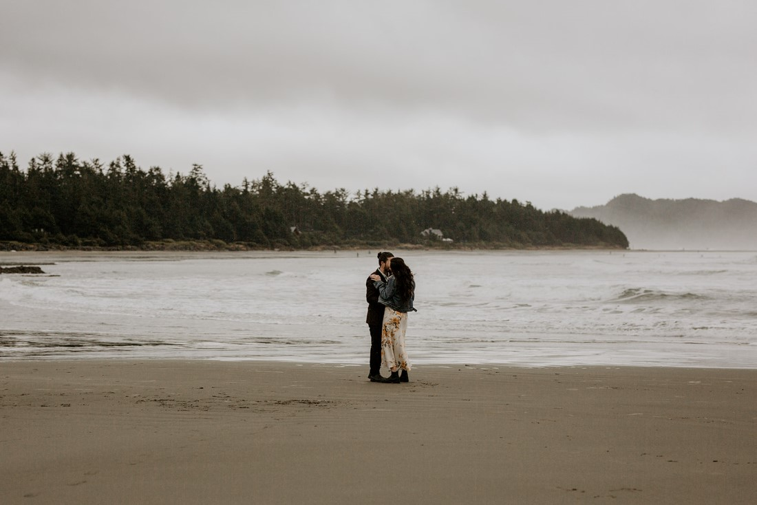 Wickaninnish Eloping couple along the waters edge of Chesterman Beach