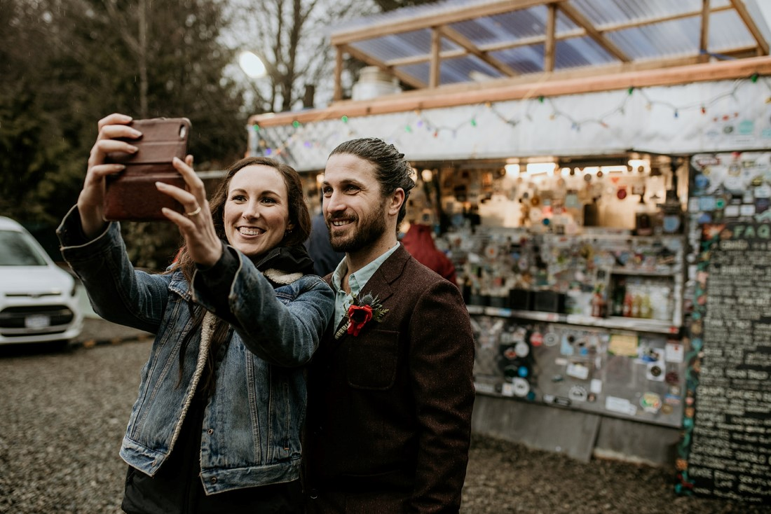Tofino Vows Newlyweds take a selfie at Tacofino truck