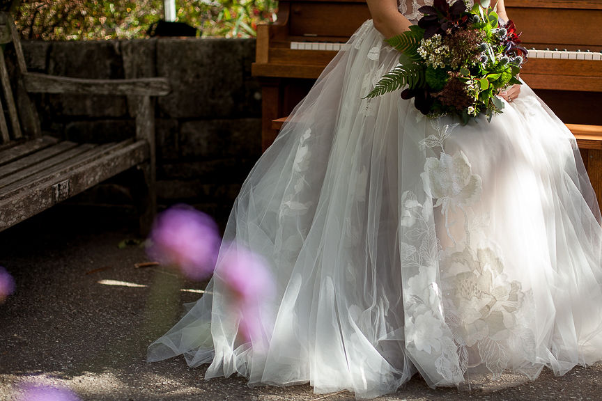 Skirt of Willowby by Watters gown and bridal bouquet