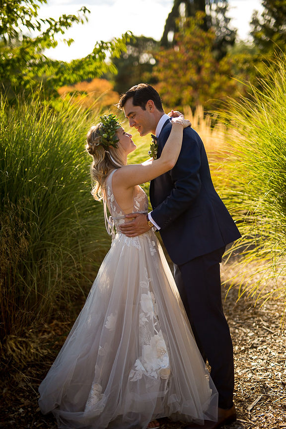 Bride and groom in tall golden grass near Vancouver