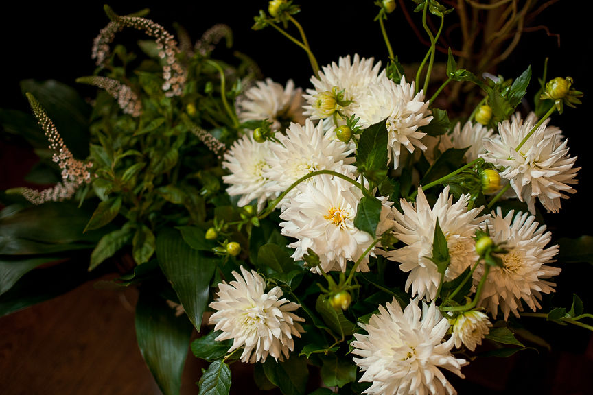 White dahlias and greenery on wedding table by Flower Factory Vancouver