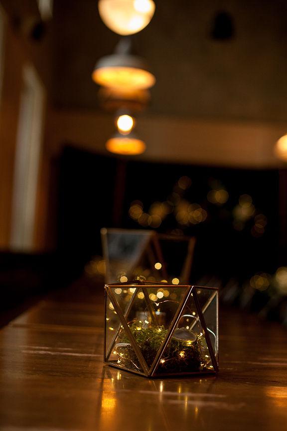 Twinkle lights inside of vase on wedding table at Medina Cafe in Vancouver