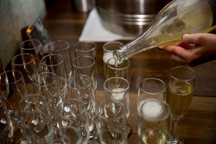 Champagne poured into glasses at Medina Cafe Vancouver