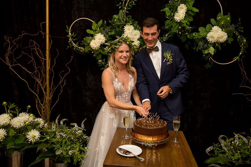 Newlyweds cut their cake at Meridan Cafe Vancouver