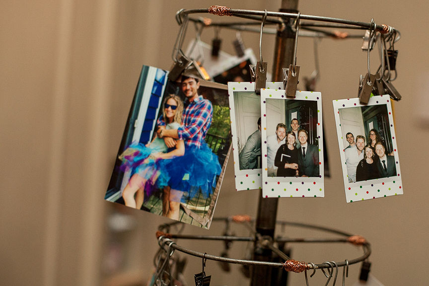 Childhood photos on wheel at wedding guest table in Vancouver