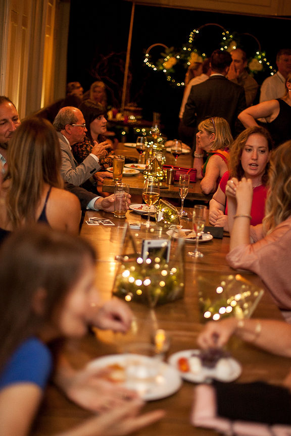 Wedding Guests sit at long table at Medina Cafe Vancouver
