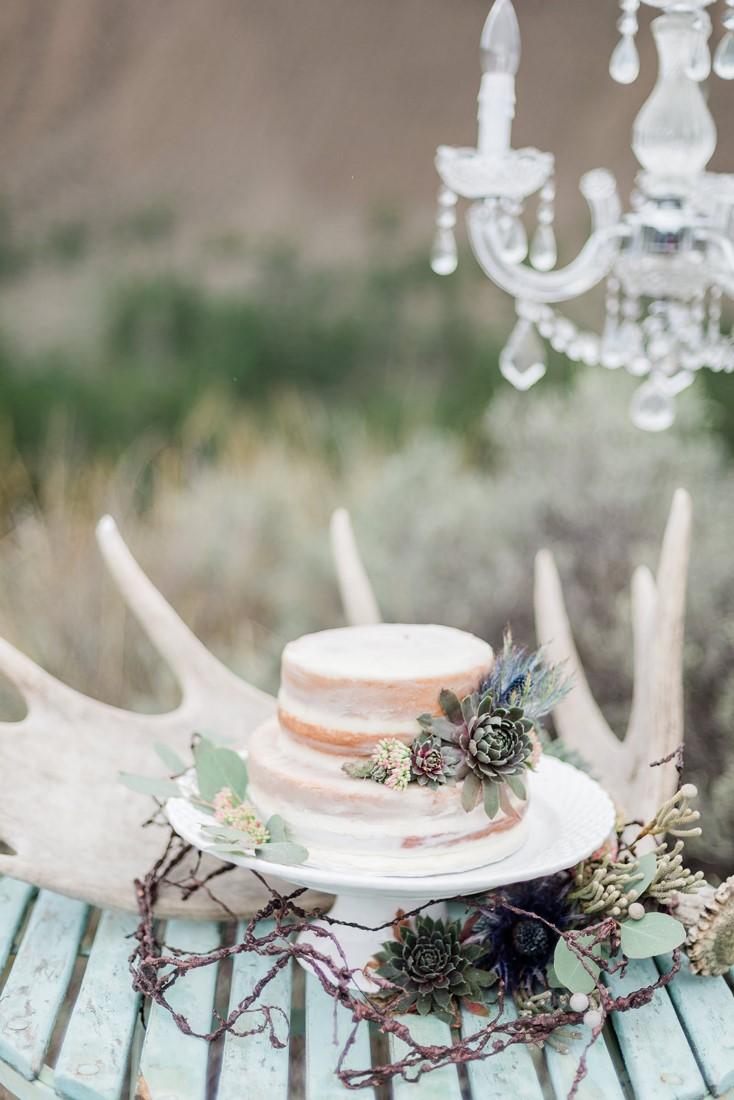 Wedding Cake sits beside skulls