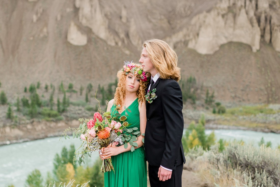 Newlyweds stand in front of BC lake