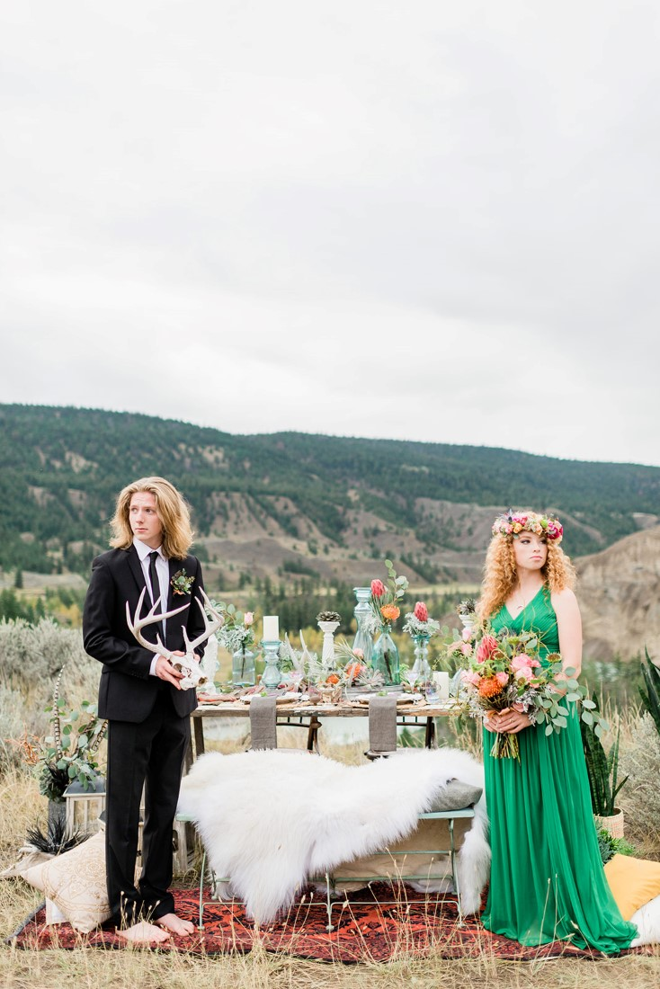 Desert Boho Inspired bridal couple look out towards the mountains