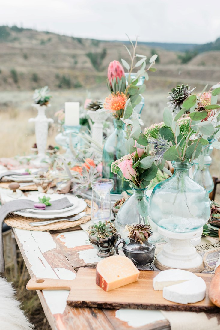 Boho Inspired Tablescape with coloured glass and colourful flowers