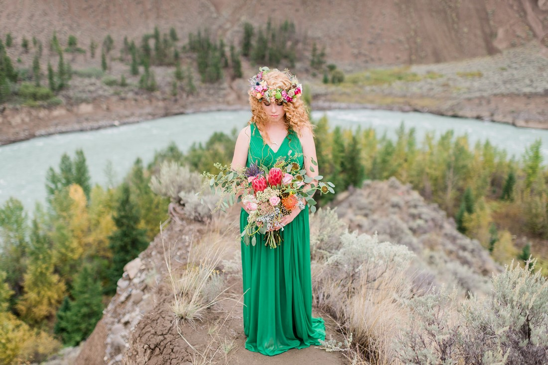 Desert Boho Indpired Bride in emerald green dress with hair wreath by Roberta McLean Photography