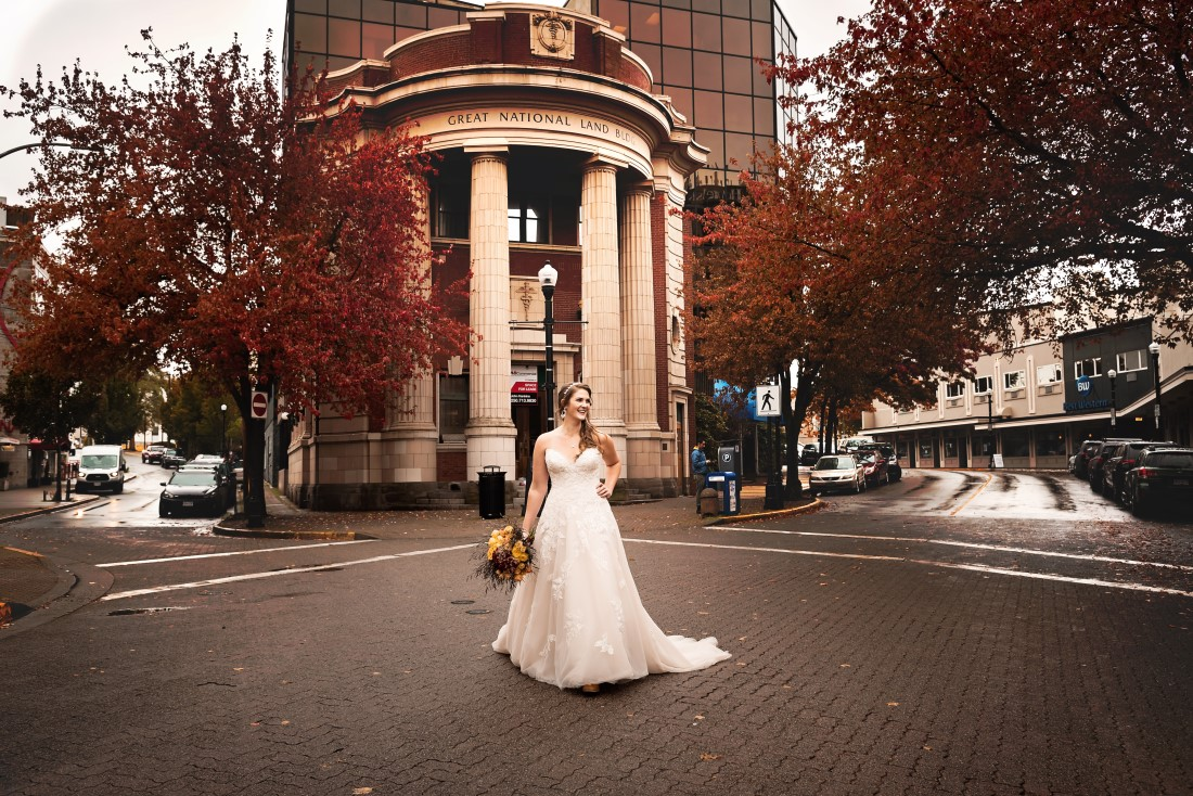 Bride laughs as she poses in the streets of Nanaimo