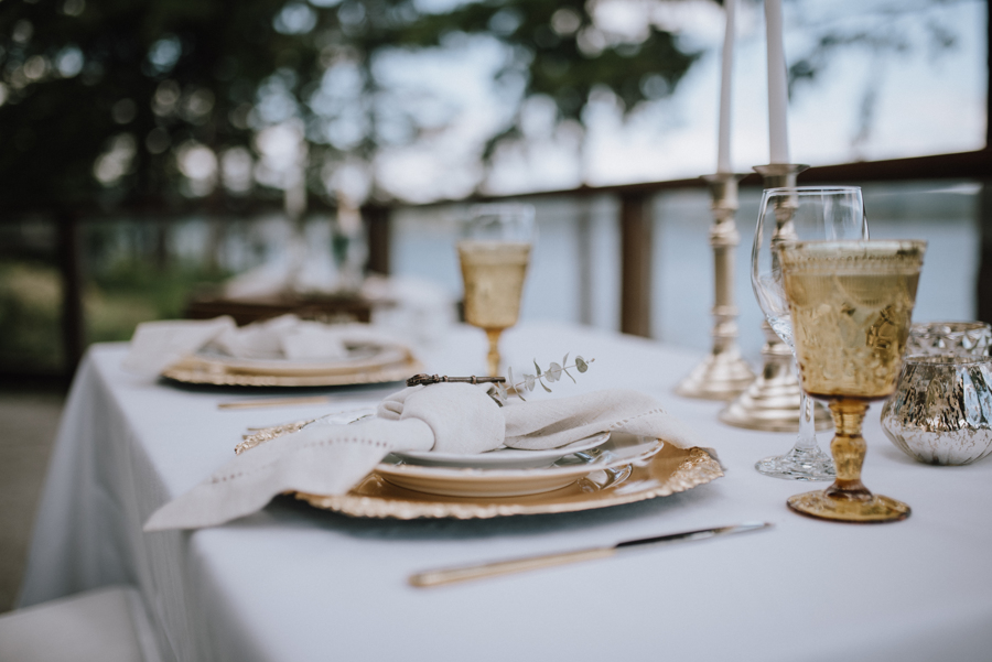 Dolphin's Resort Wedding Romance table with golden wine glasses and mountain view in Campbell River