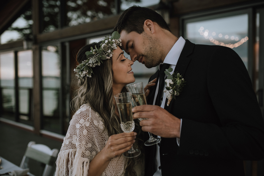 Bride and groom drink champagne by All in 1 Party Supplies Comox Valley