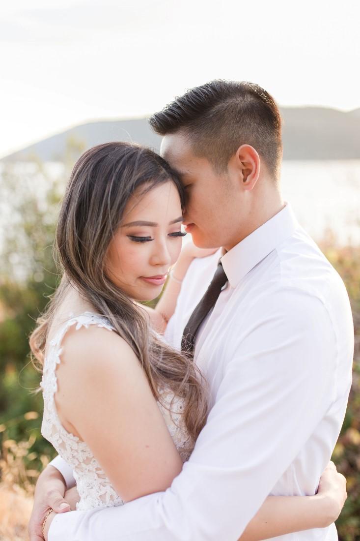Whytecliff Park Engagement shoot asian couple embrace