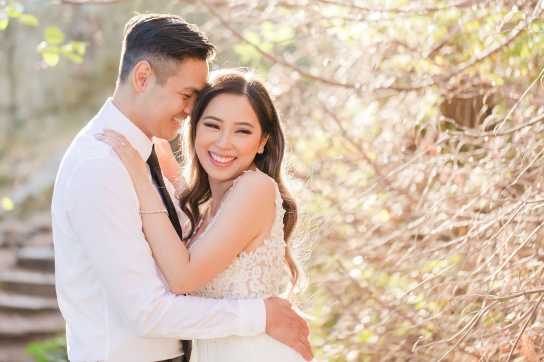 Bride to be smiles while embracing her fiance