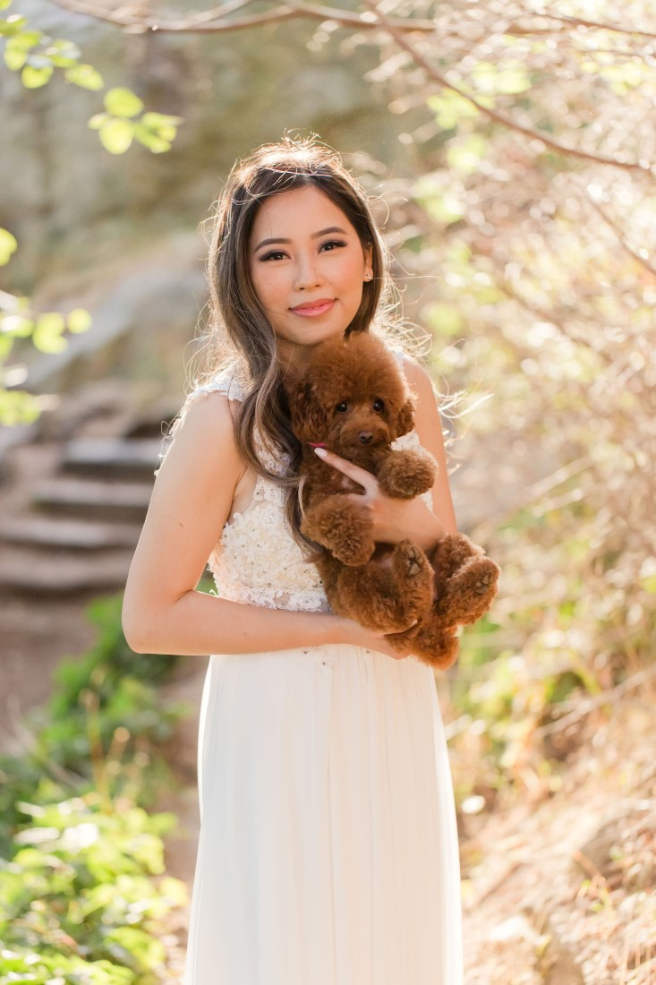 Puppy held by engaged bride to be in Vancouver