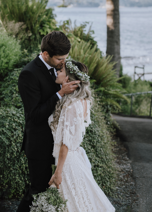 Dolphin's Resort Wedding Romance bridal couple by ocean against green wall