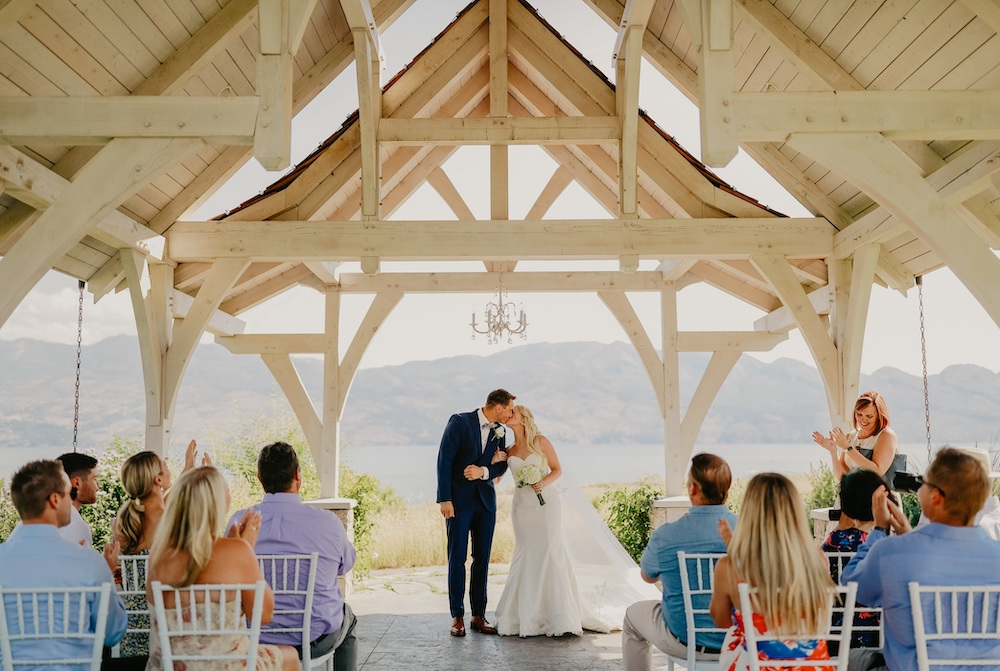 Couple marry under the large roof at Sanctuary Gardens in Kelowna