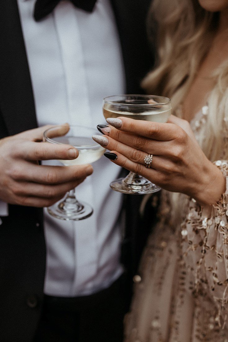 Champagne glasses held by sophisticated couple on date
